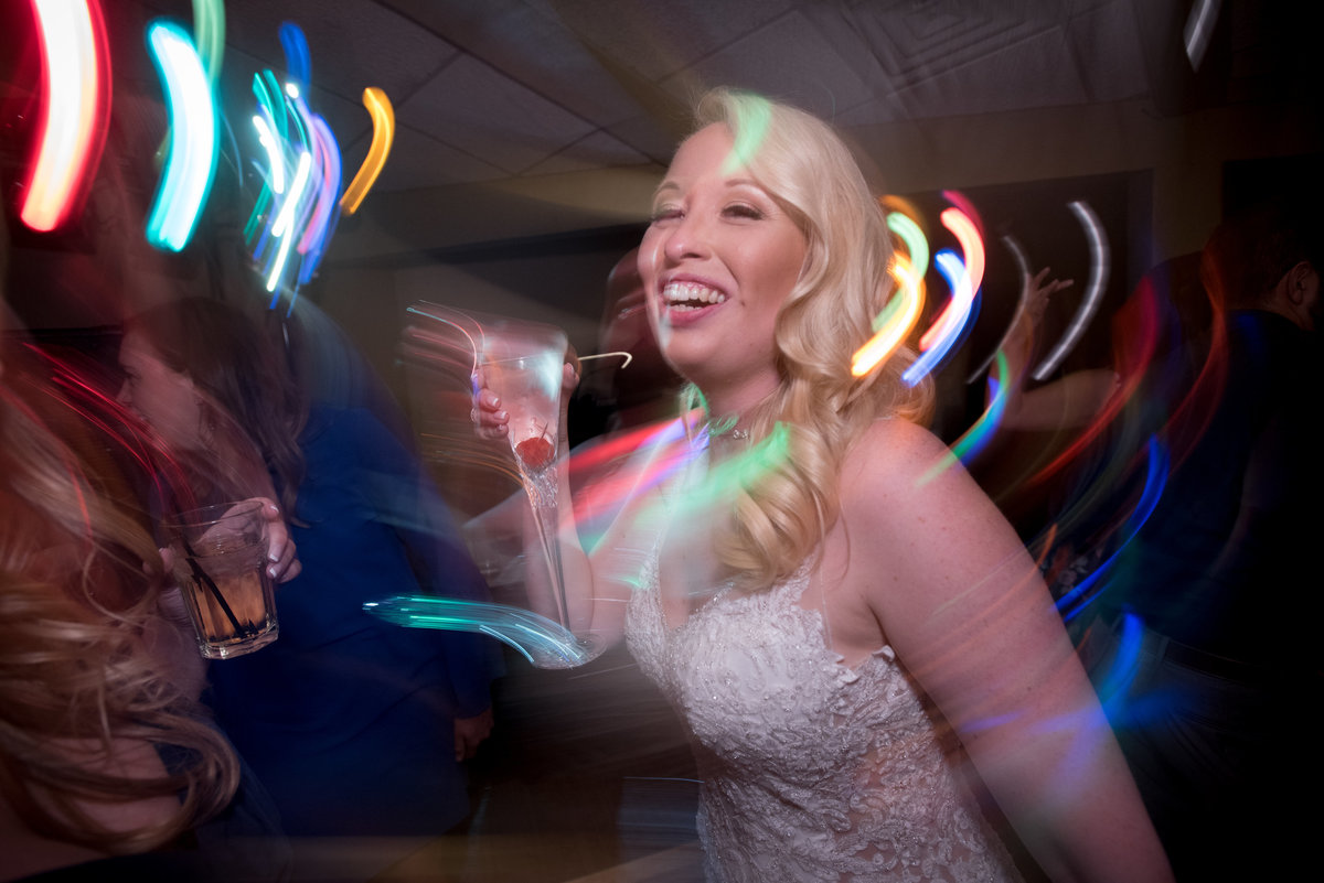 bride dancing with champaign with swirling lights