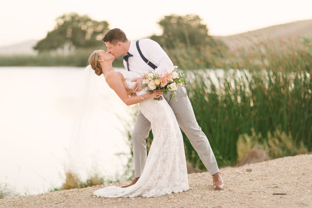 Groom dips Bride at Firestone Vineyard wedding