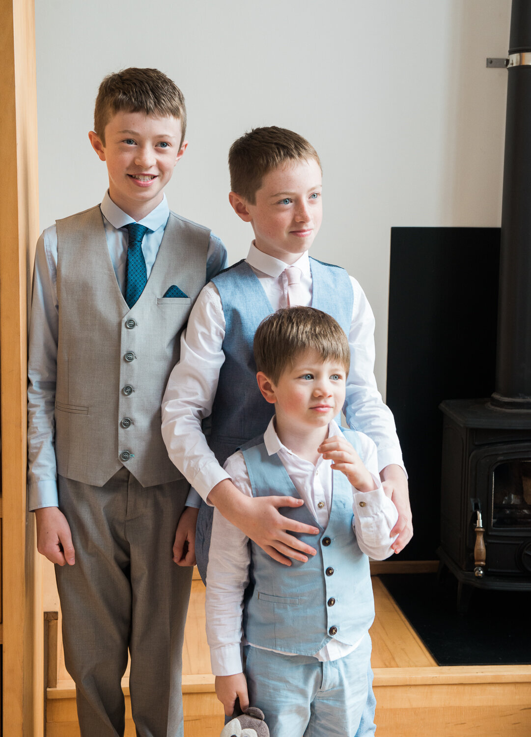 Three brothers in wedding suits