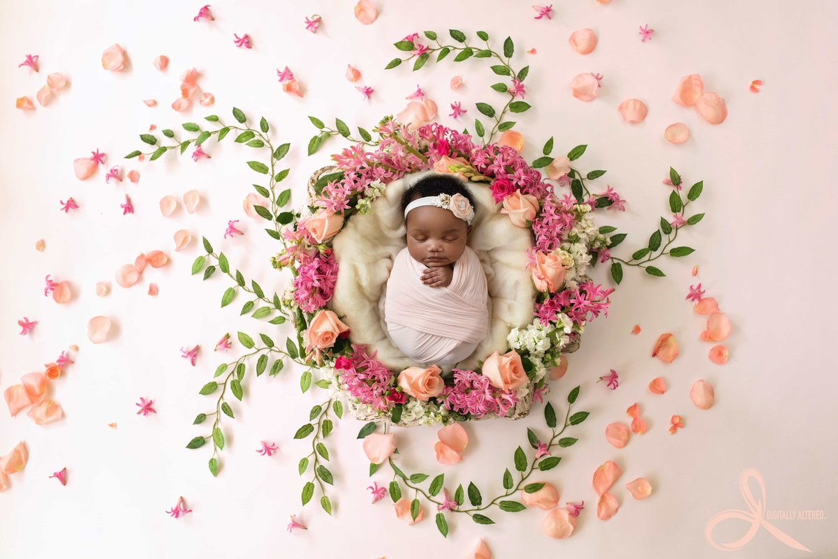 Little girl in a wreath of flowers & petals