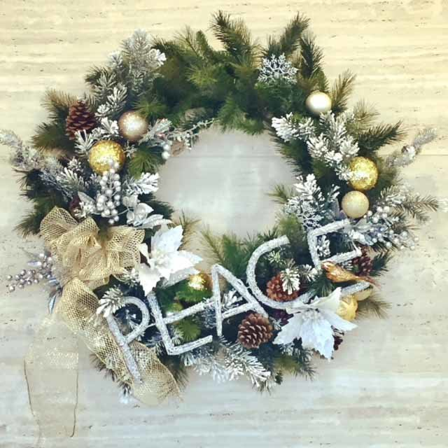peace holiday wall wreath with evergreen and silver ornaments