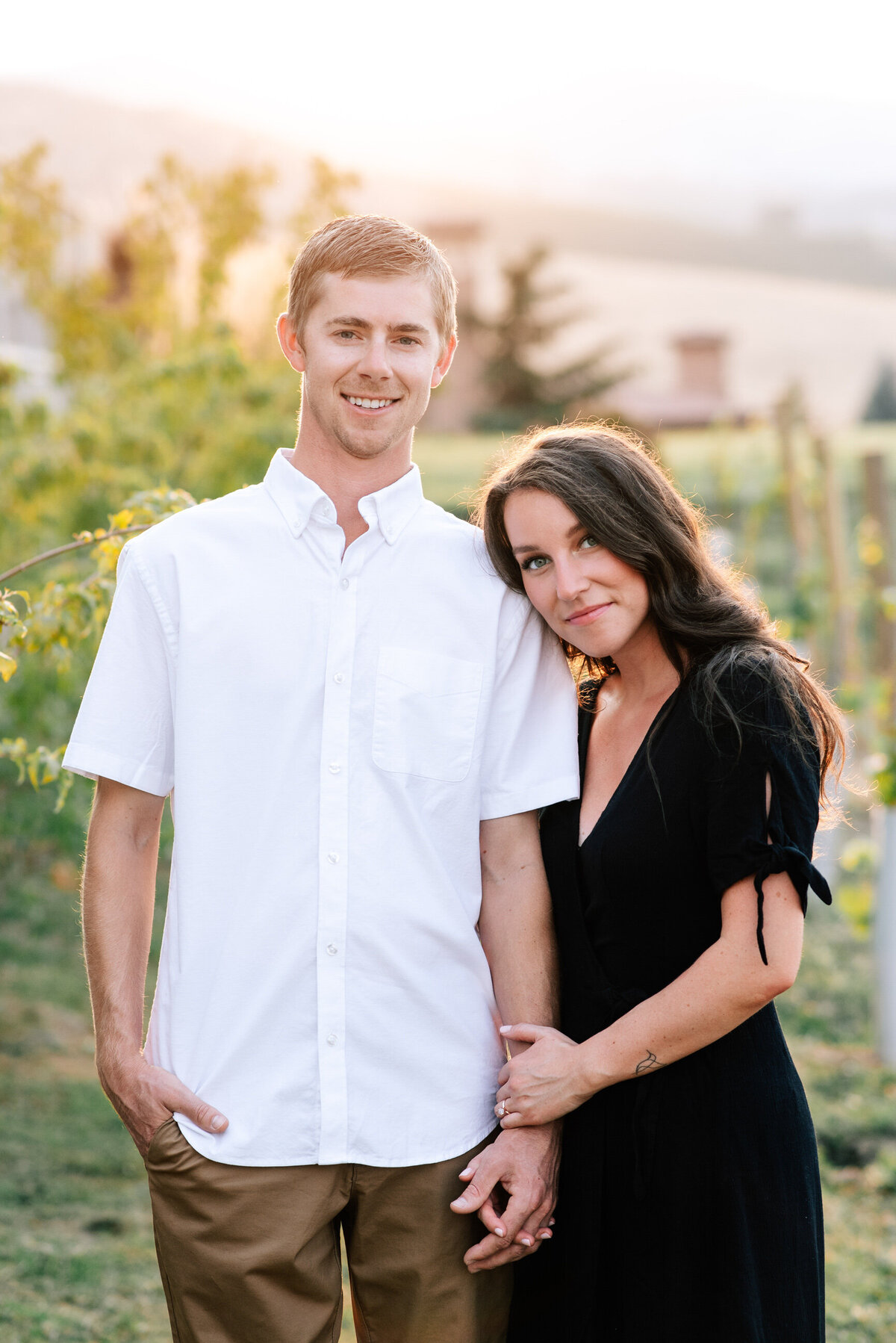 Portrait of couple during Lake Chelan sunset engagement session at Larc Hill Vineyard Ranch