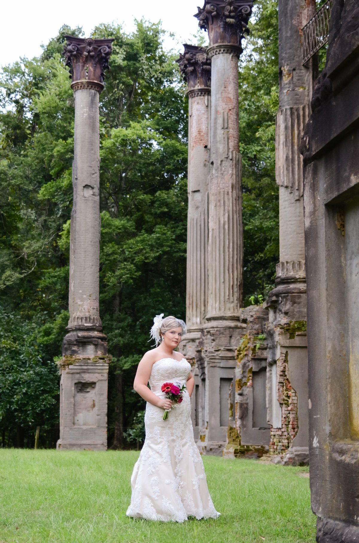 Beautiful bridal portrait photography: Bride with bouquet among the ruins of Windsor plantation in Port Gibson Mississippi