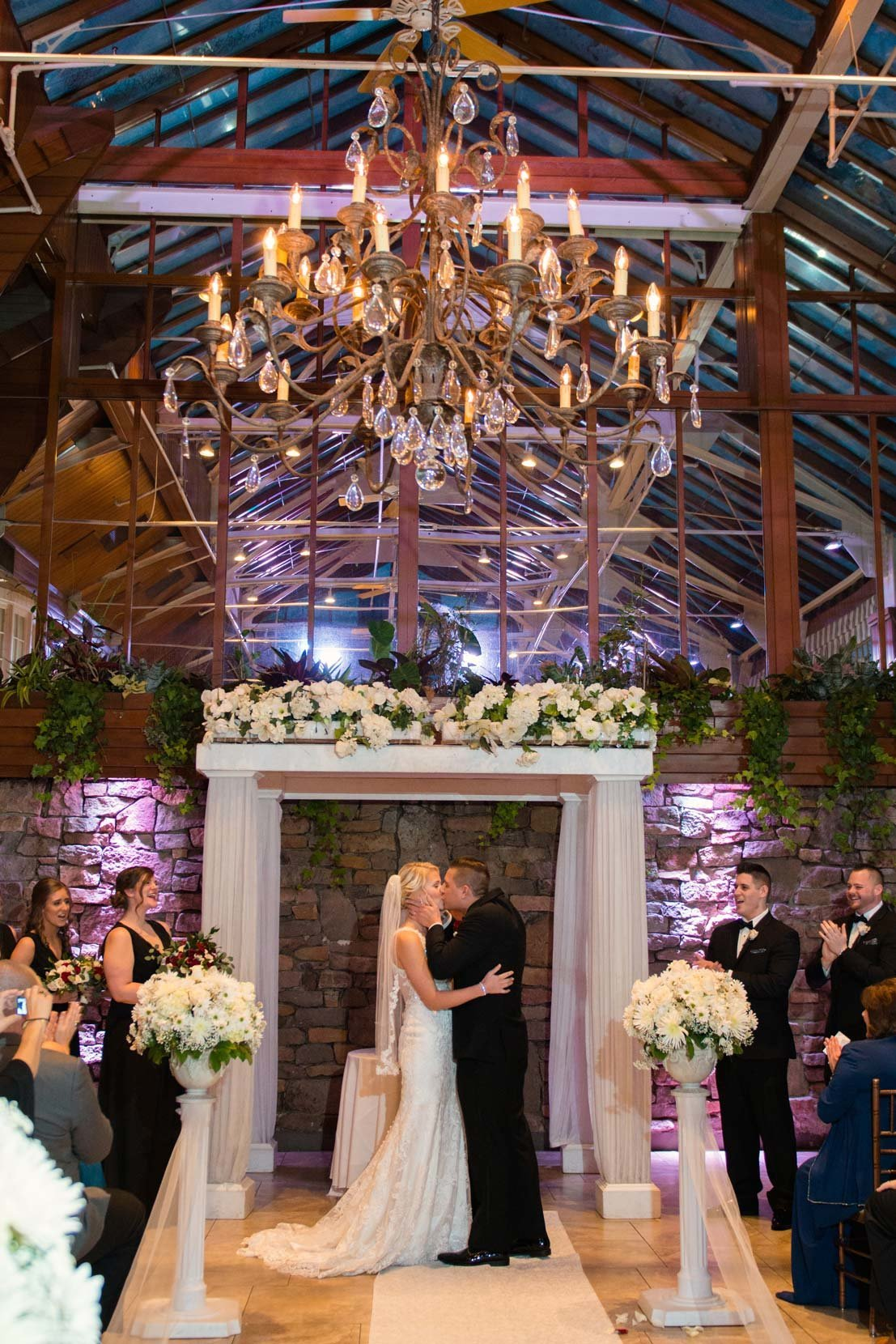 Bride and groom kissing during their ceremony at Fox Hollow