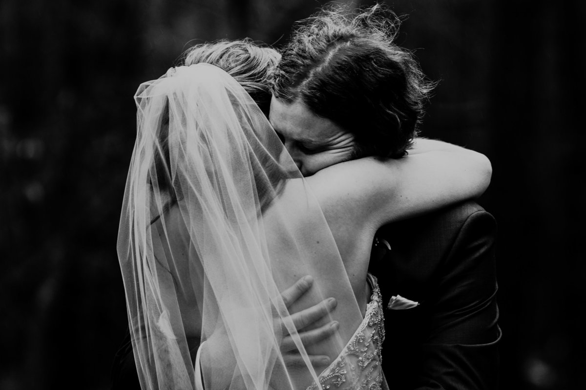 Black and White sets the tone of this gripping and emotional hug of a bride and groom as they see each other for the first time