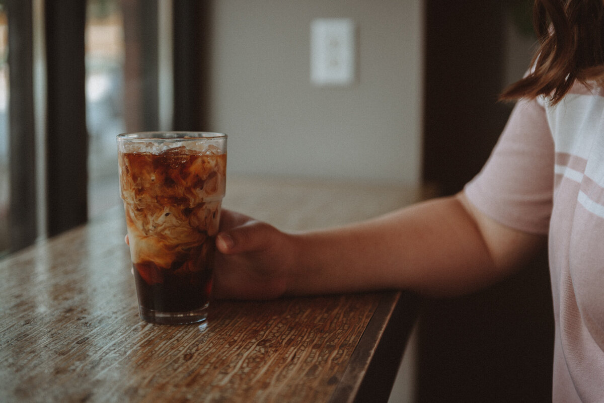 Teenager-photographed-holding-glass-of-soda