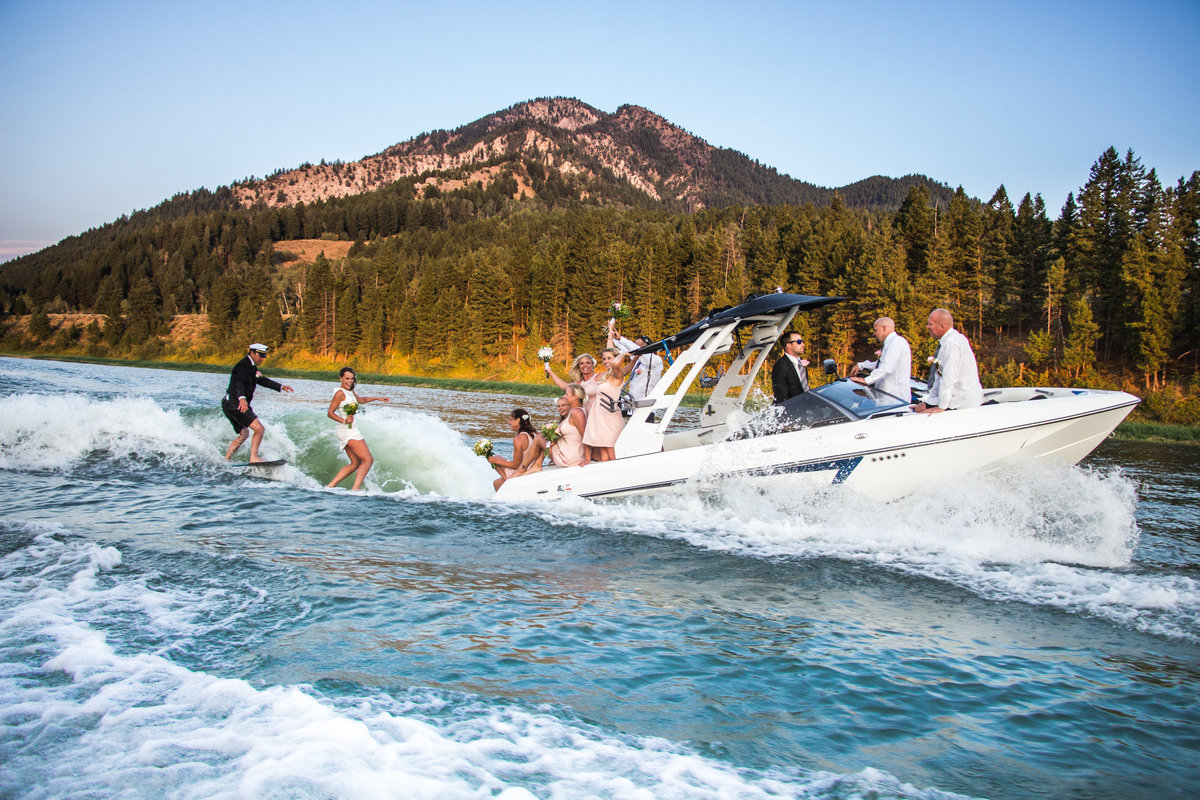Wedding on the water, Bride and groom surfing, Palisades Lake, Wedding party, boat, evening, colorful