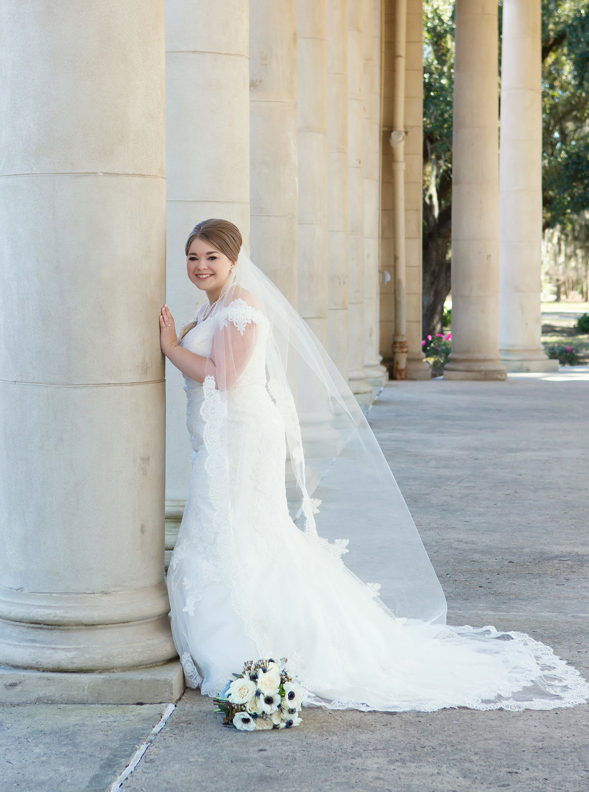 bride-leaning-on-cement-column