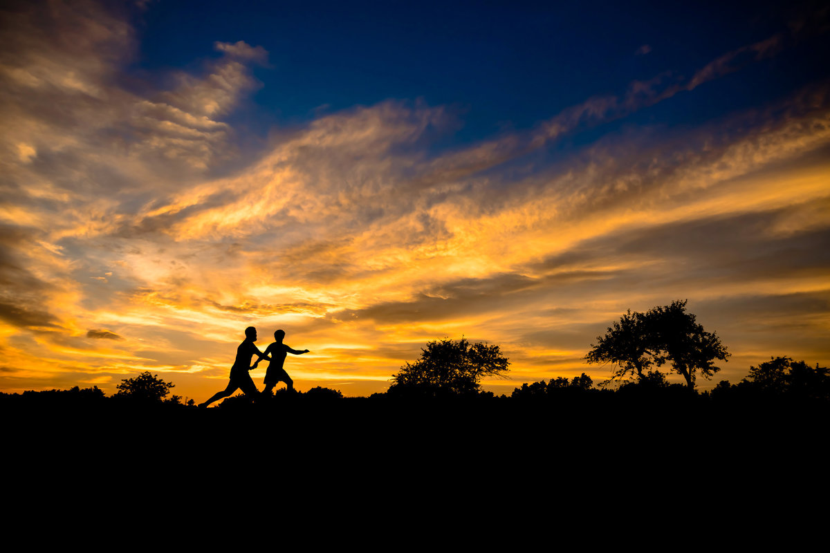 A sunset serves as a backdrop for the couple during their Dover NH engagement session