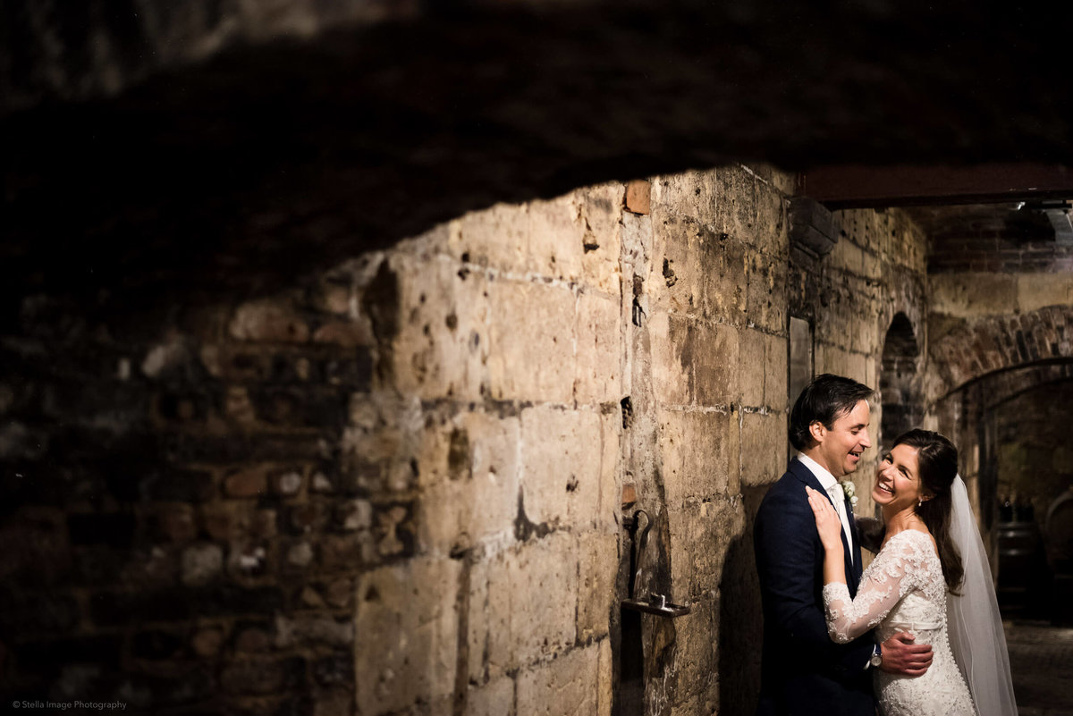 Bride-and-groom-in-wine-cellar