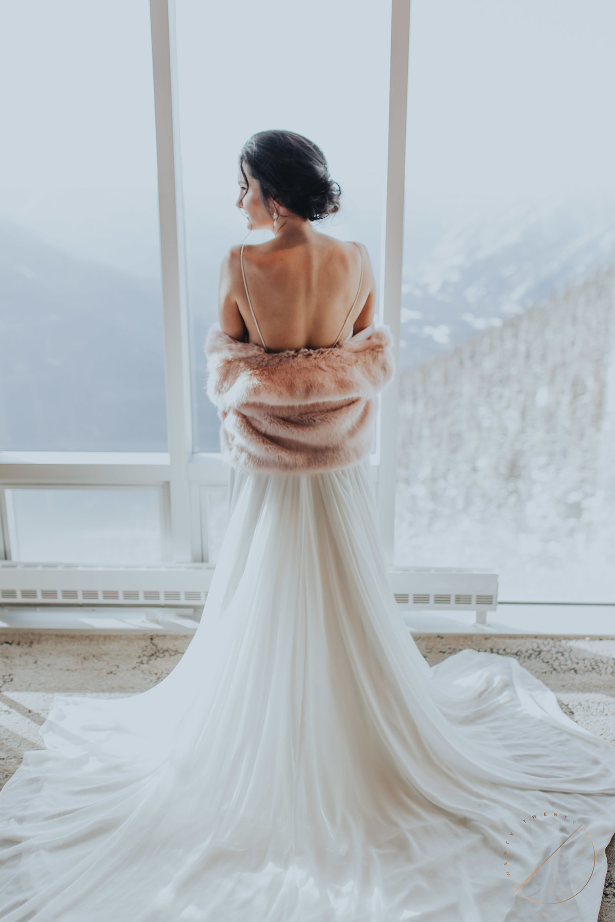 bride portrait in Sky Bistro at Banff Gondola by Twenty Twenty Photography
