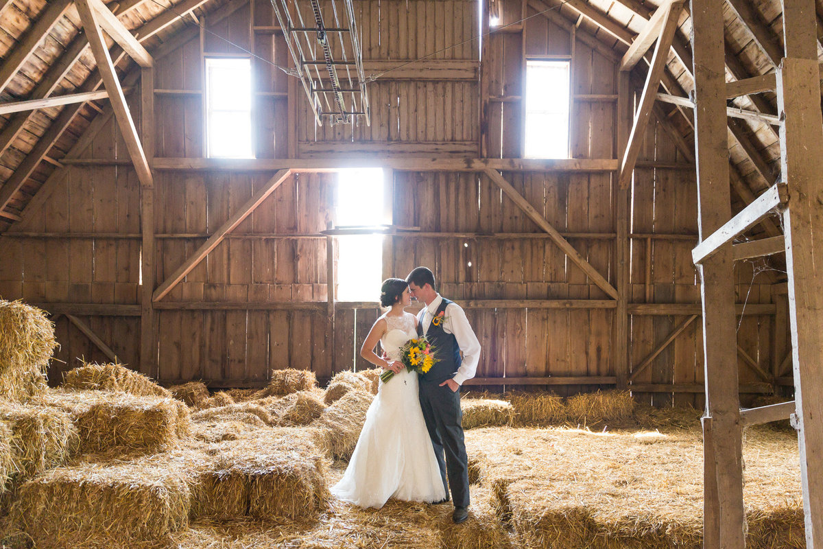 Barn photographs of a wedding day for a couple dairy farmer kids on their wedding day