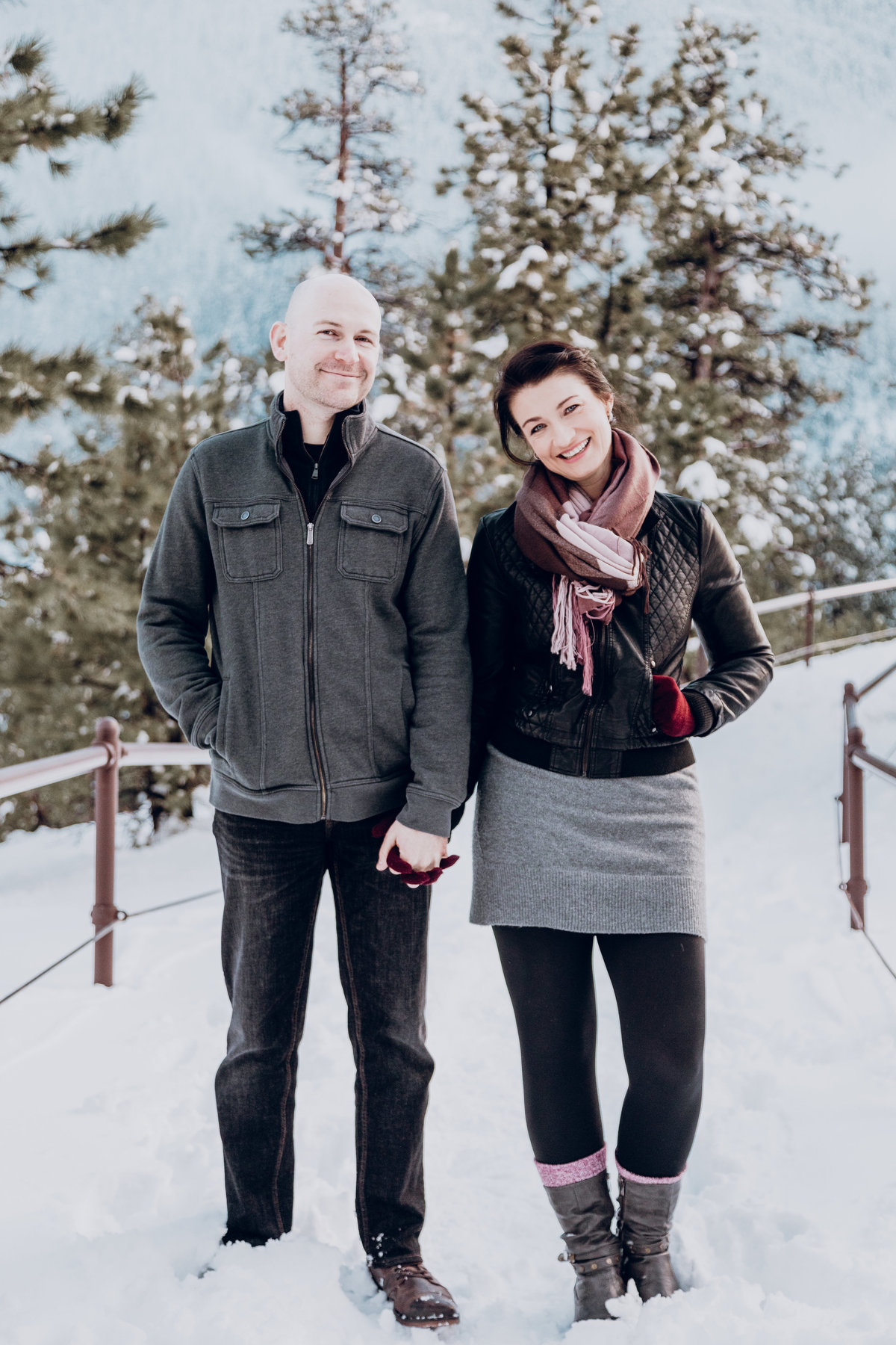 Lake Tahoe engagement photos couple poses on snowy hilltop