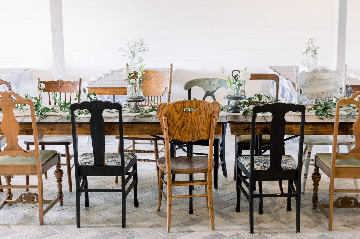 rustic chairs set up for a wedding, formal dining set up