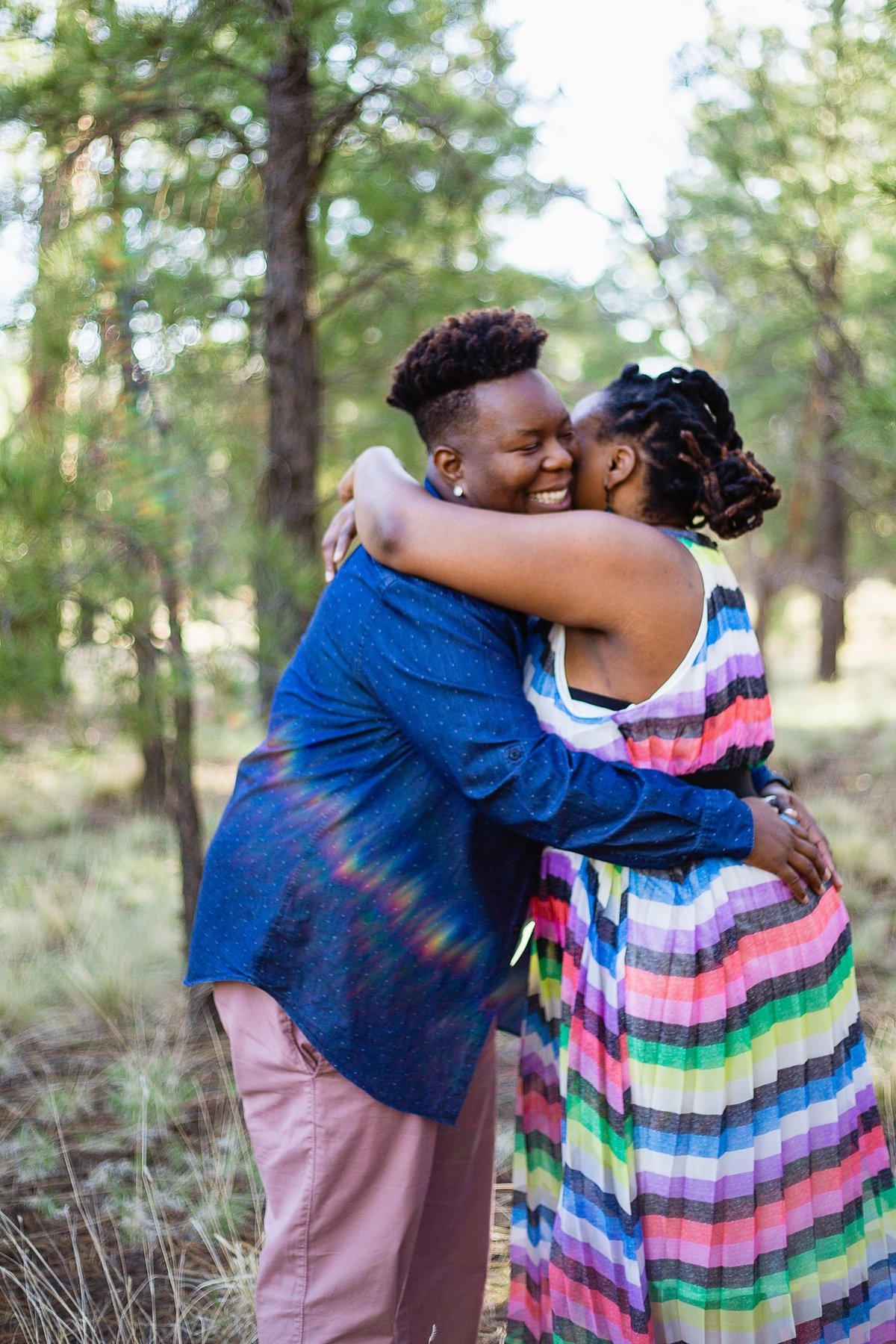LGBTQ couple hugging during their Flagstaff engagement session by PMA Photography.