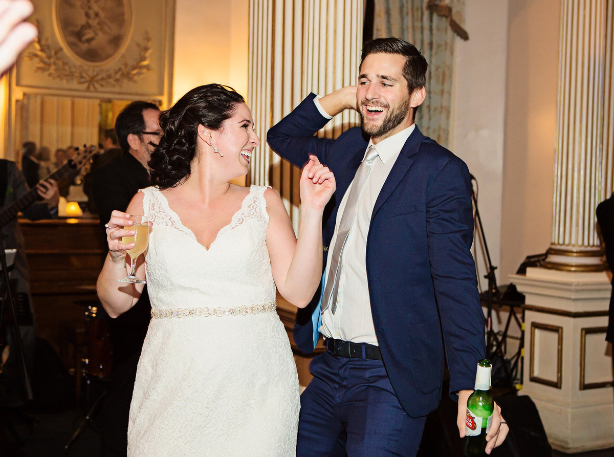 New Orleans bride dances with her brother at wedding reception at The Columns Hotel