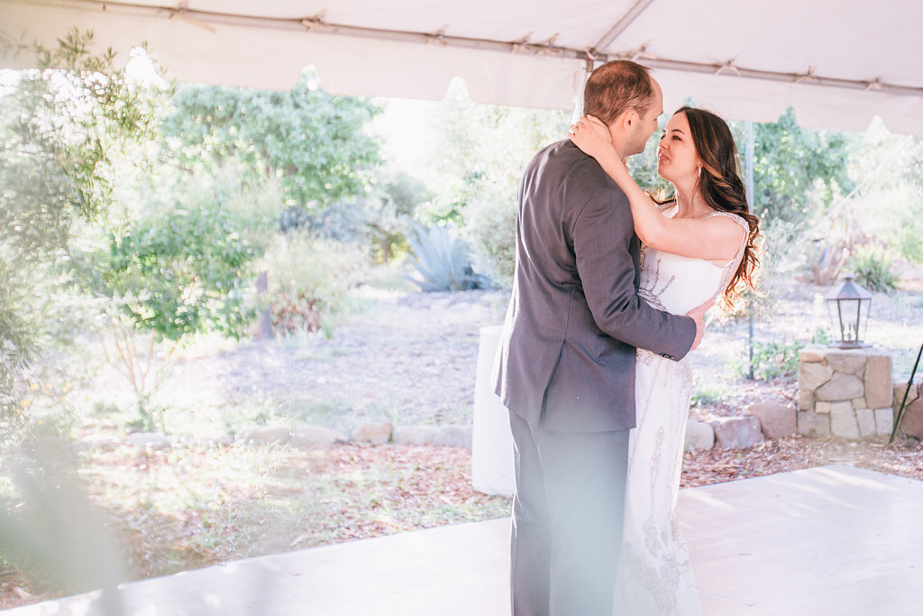 bride and groom first dance at desert wedding reception in Ojai