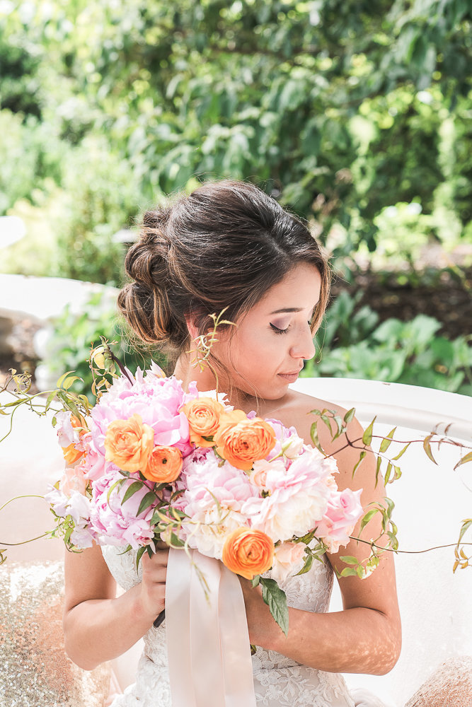 Spanish bride with orange, pink, and white bouquet