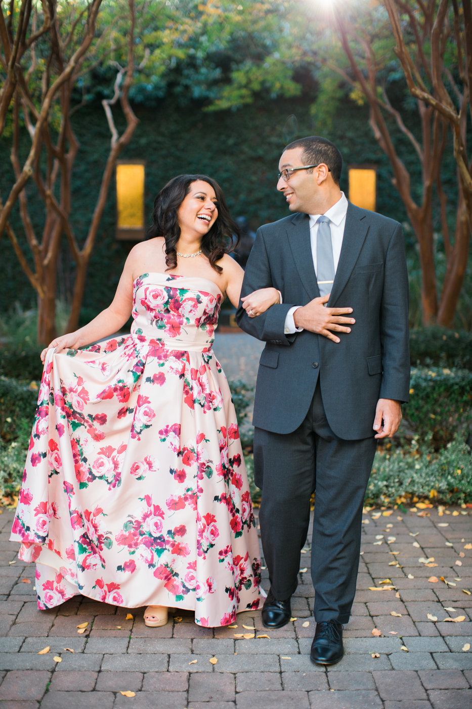Wedding Photographer, woman in floral dressing walking arm in arm with her man