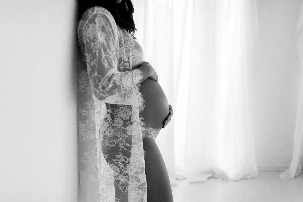 black and white image of baby bump