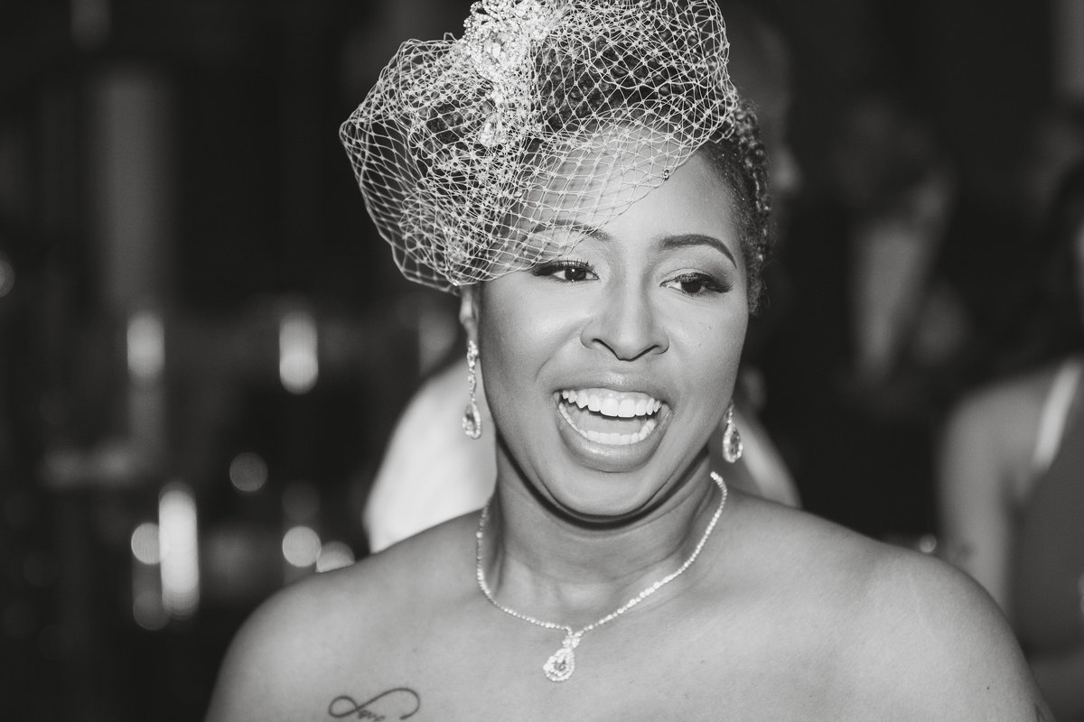 black and white of bride laughing