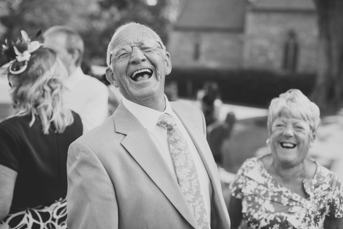 grandad laughing outside the church