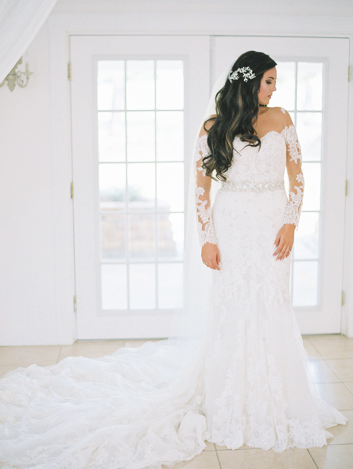 Bride dressed in lace wedding gown