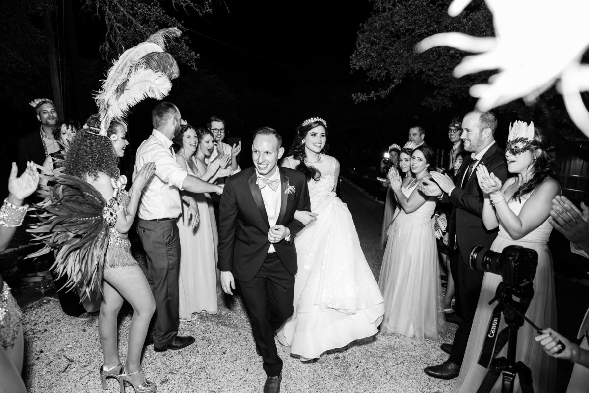 addison grove wedding photographer bride groom exit carnival dancers 11903 Fitzhugh Rd, Austin, TX 78736