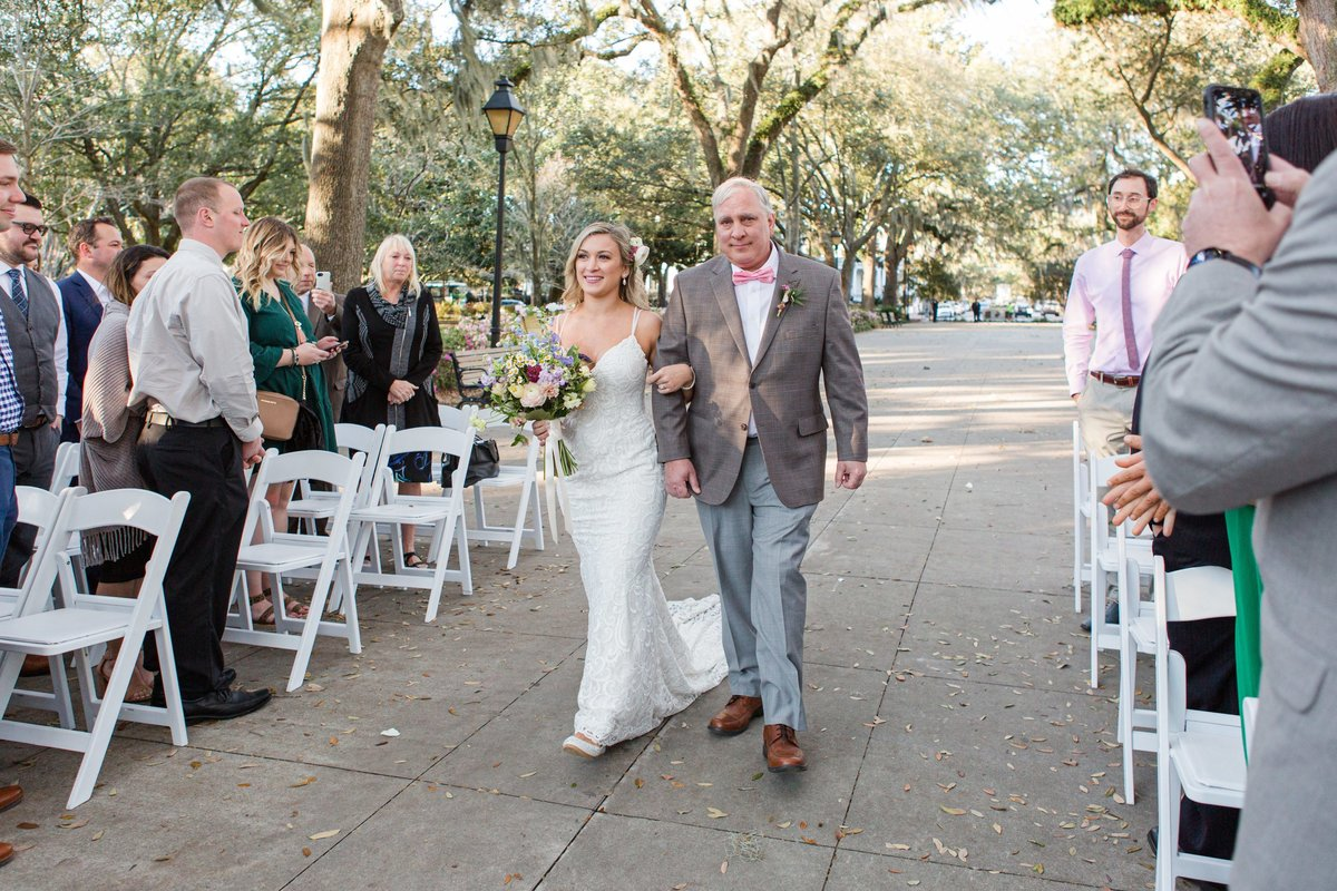 bride and dad walking down aisle at wedding