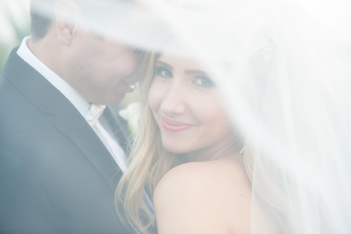 vintage villas wedding photographer bride under veil 4209 Eck Ln, Austin, TX 78734