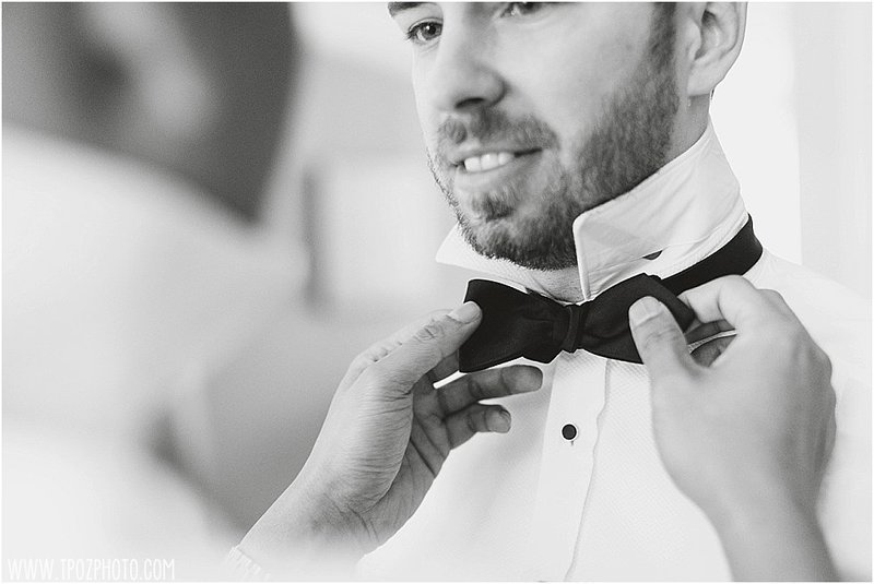 gay couple tying a bowtie