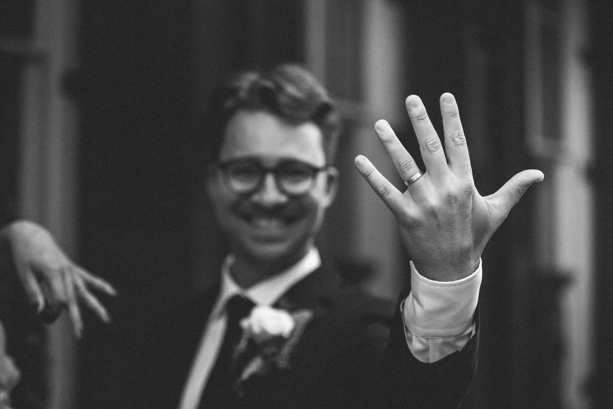 Groom shows off his ring after wedding ceremony  in New Orleans French Quarter