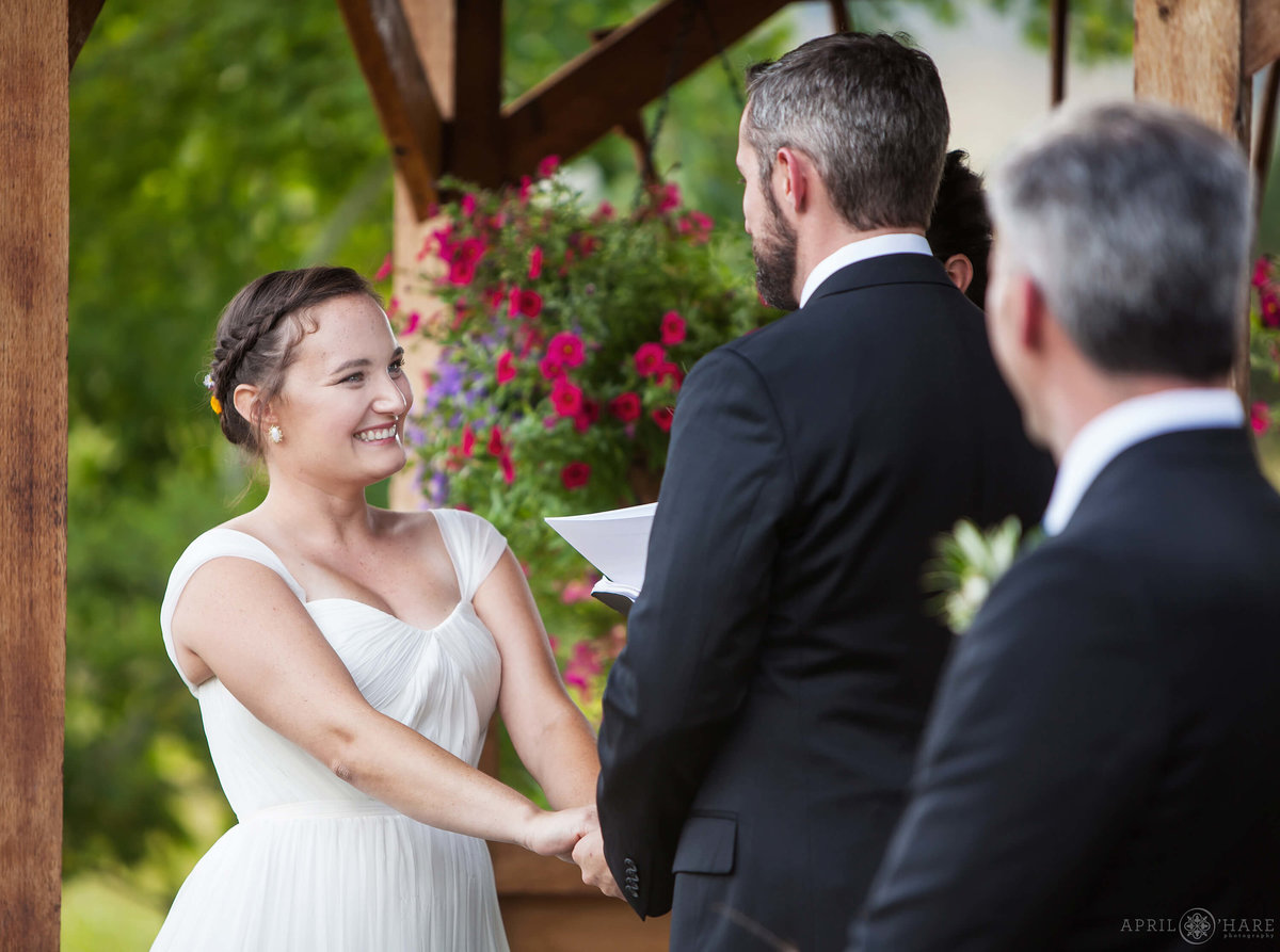 Beaming bride during outdoor wedding ceremony at Denver Botanic Gardens Chatfield Farms