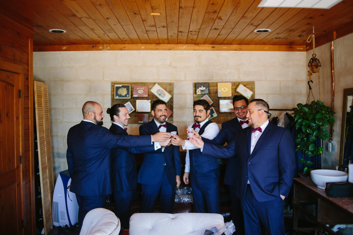 groom and groomsmen toast during getting ready right before ceremony at Oaks at Heavenly venue