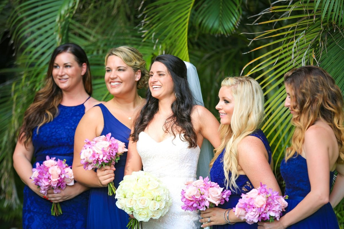 Capture Aloha Photography at The Westin Maui Resort and Spa with bride and bridesmaid with bouquet