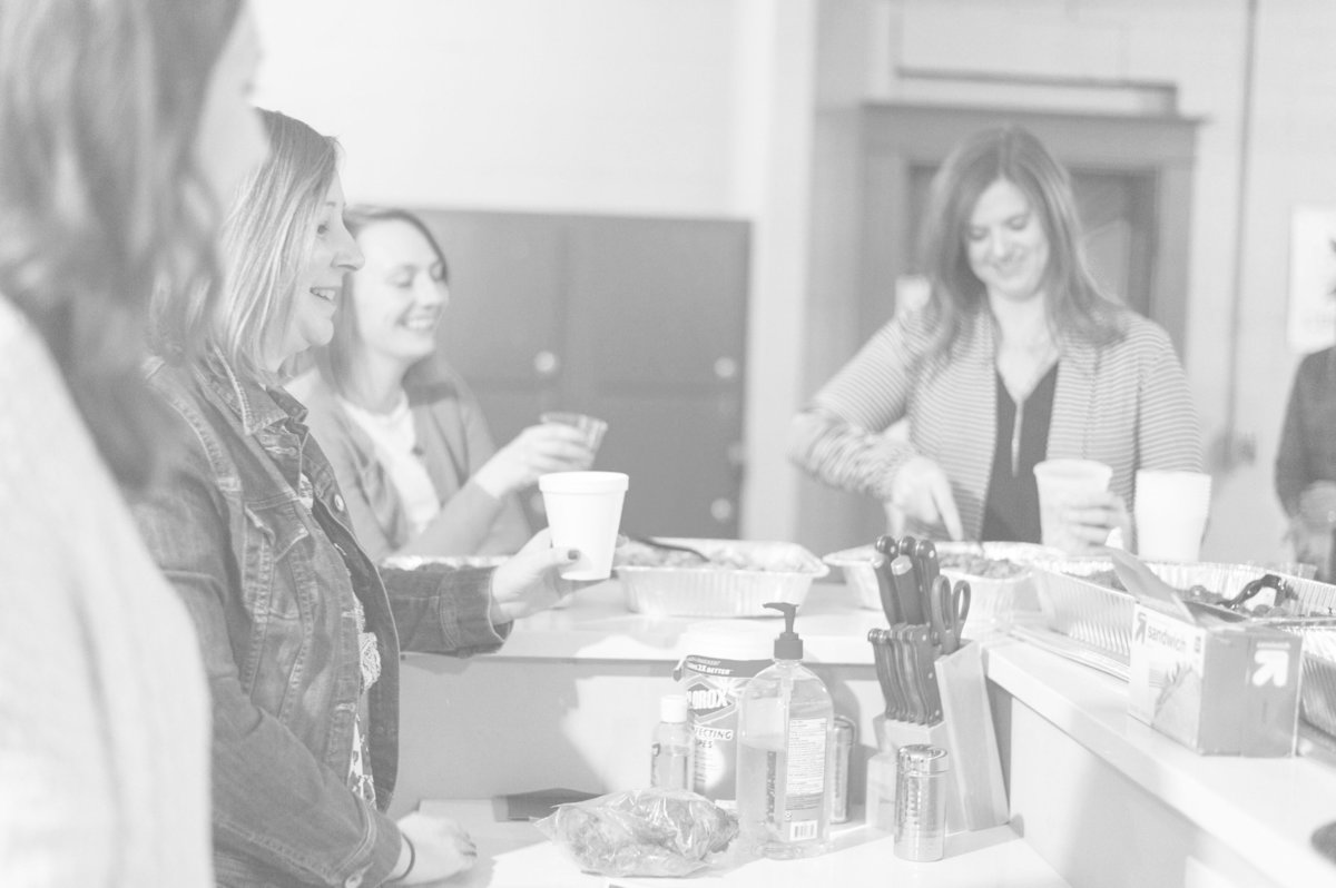 Women gather around and share food and drinks at a Cocktails & Chemo event last month.