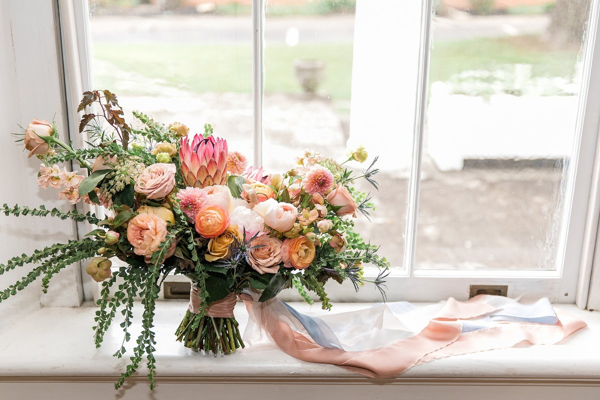 bridal-bouquet-silk-ribbon-coral-blush-protea