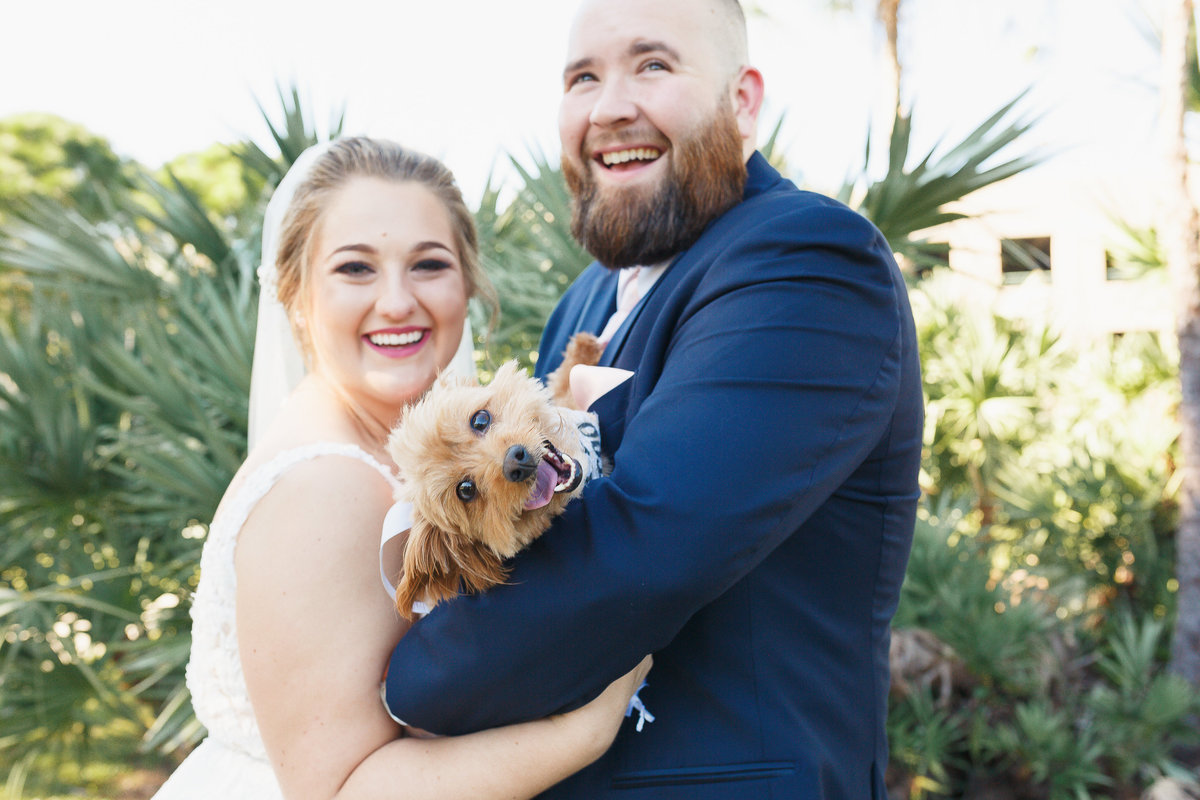 Bride and Groom with their Happy Dog During their Tampa Bay Wedding Photo Shoot