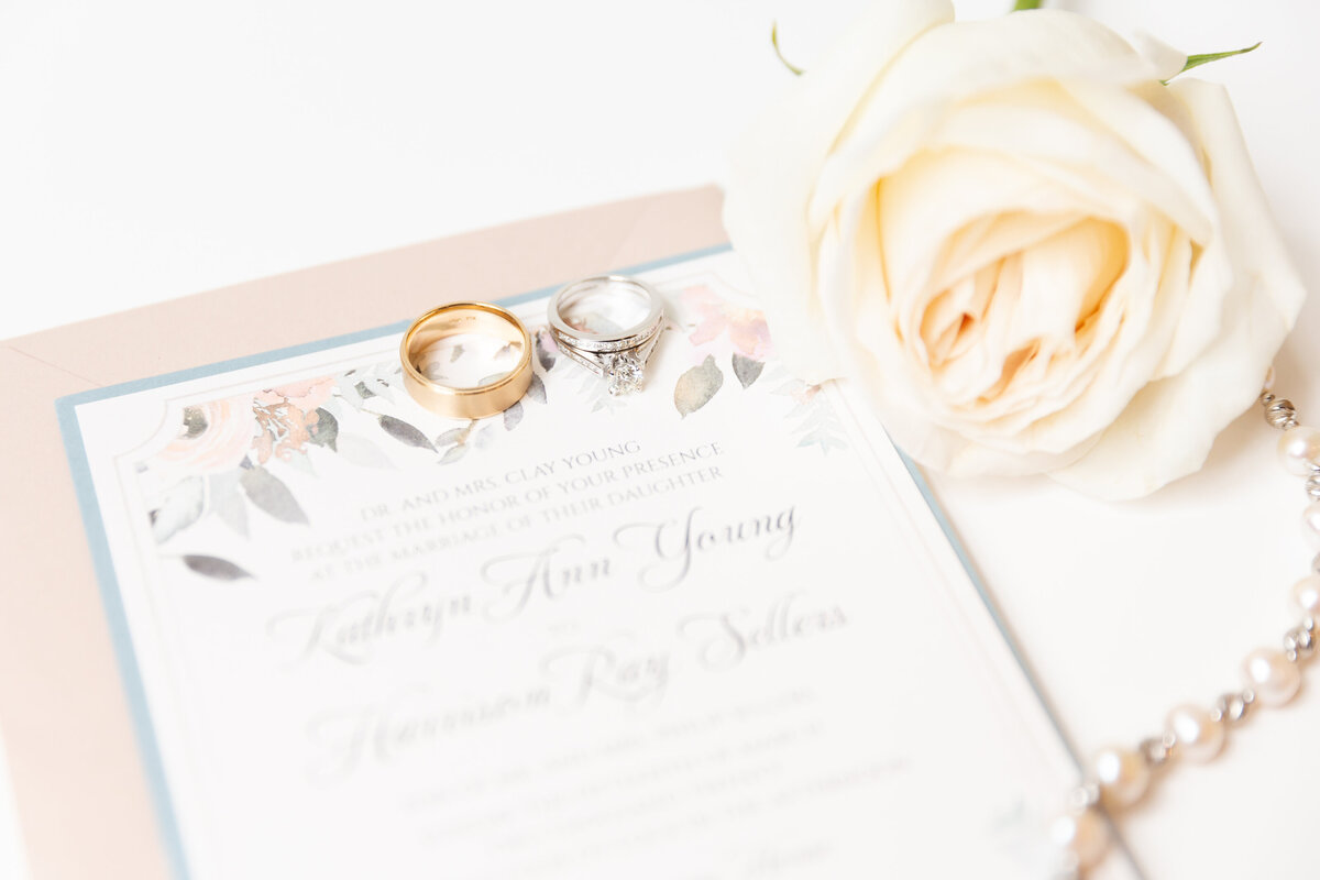 Elegant Wedding Invitation with Rings and Invitation