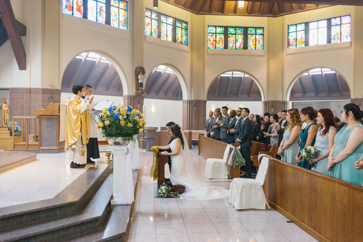 Nuptial blessing at Catholic wedding in Langley