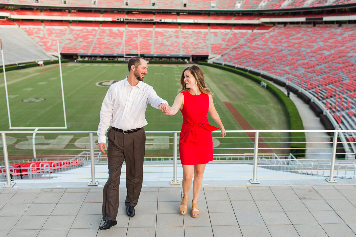 engagement photos at the university of georgia's sanford stadium in athens