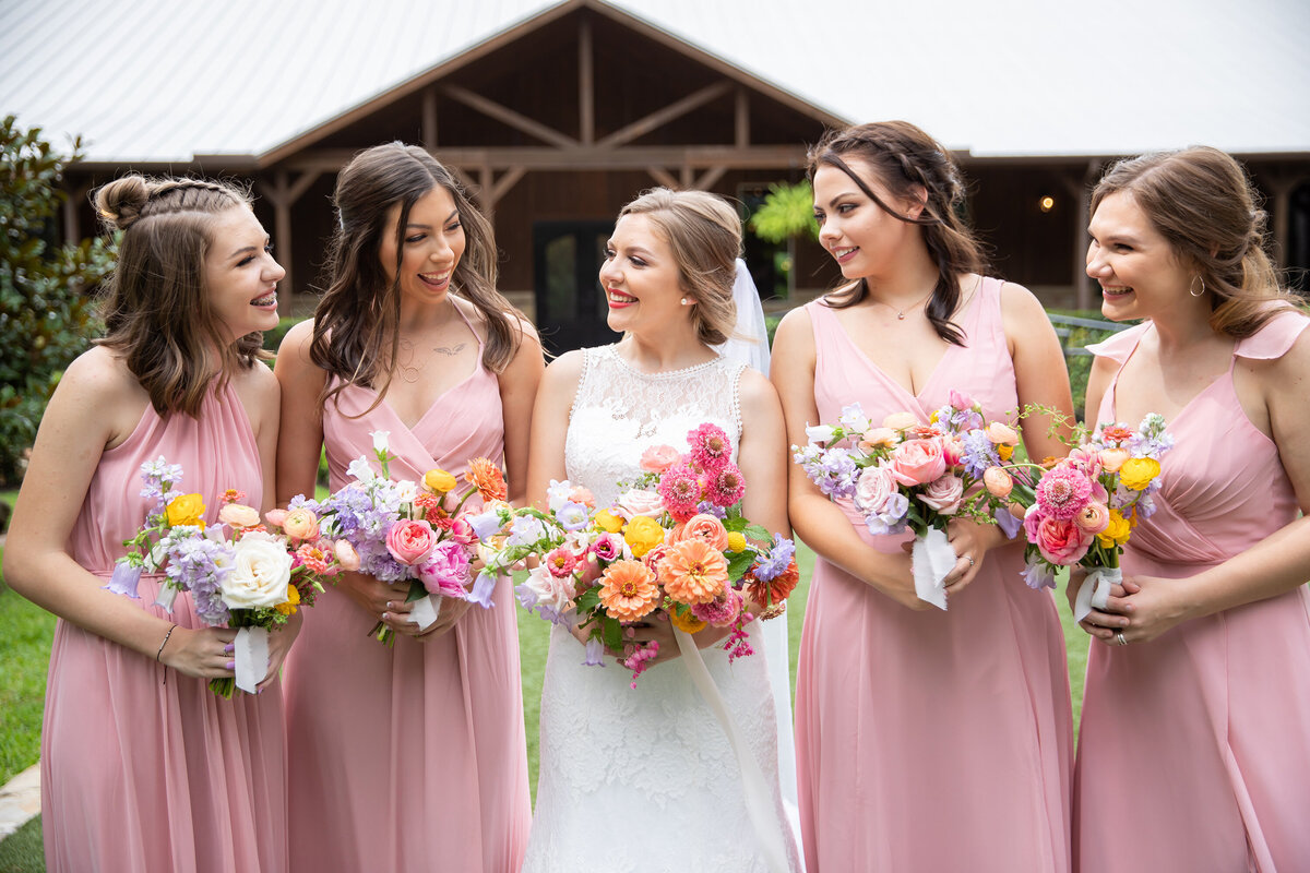 Bride and Bridesmaids with Fun Spring Floral Bouquets