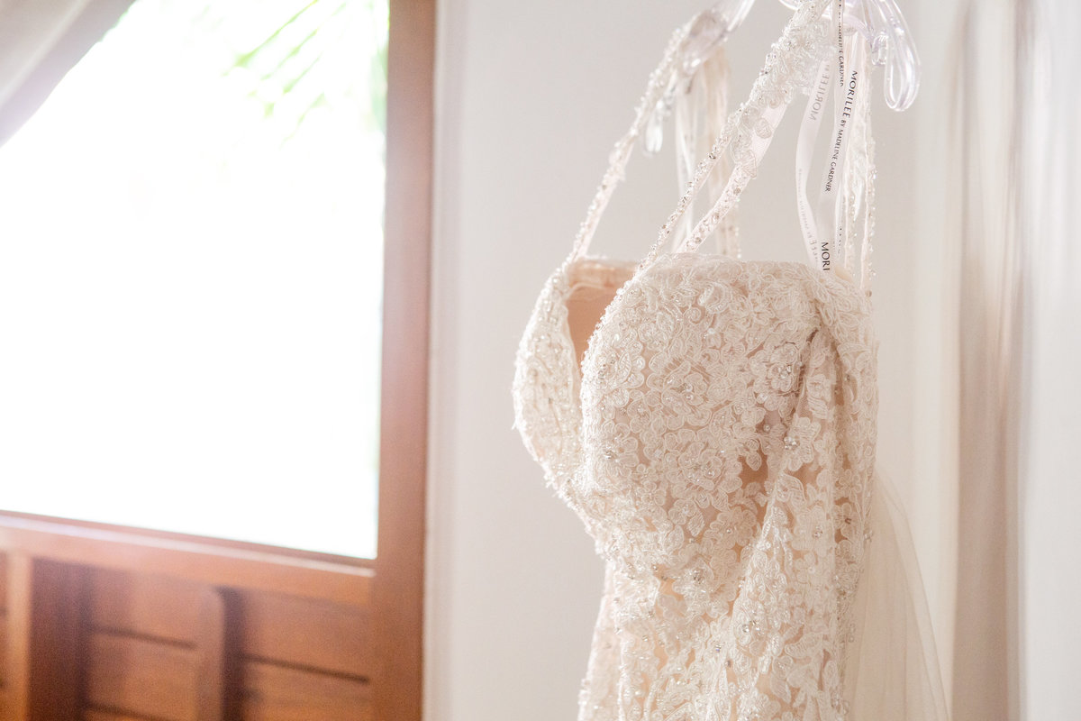 Dallas wedding dress hanging by window