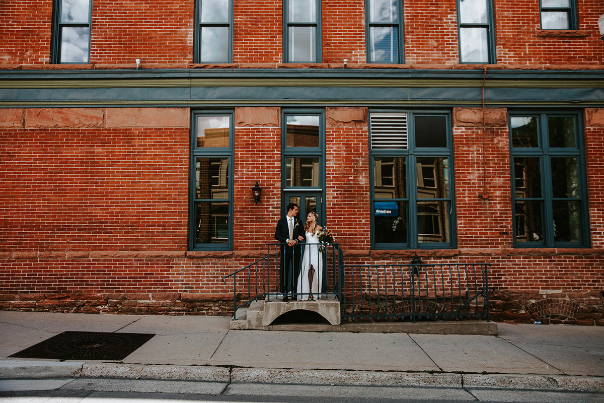 wedding couple around the side of Hotel Jerome in Aspen, CO