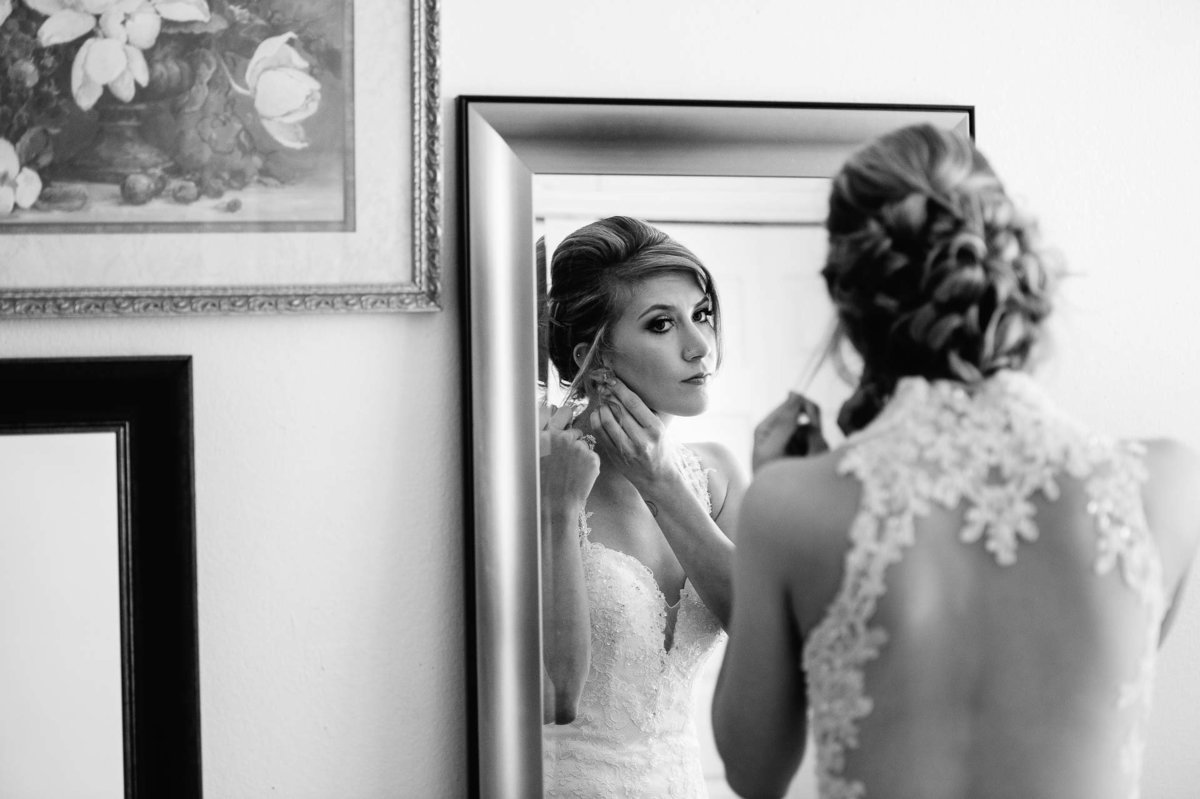 bride putting on her hearings