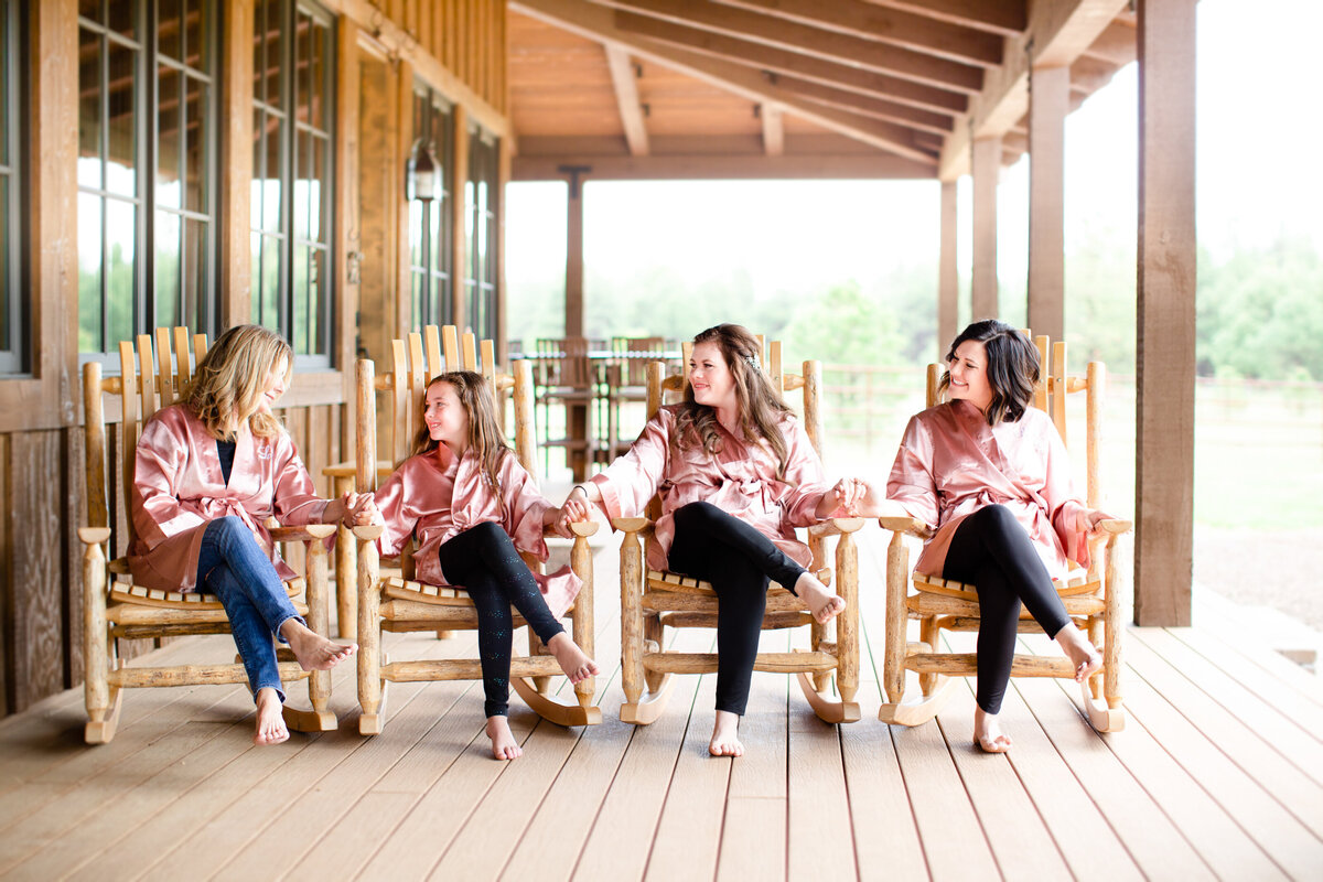 bridesmaids in rocking chairs
