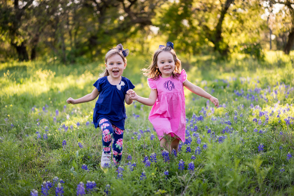 bluebonnet picture of toddler children running during family portrait session in San Antonio by photographer Expose The Heart