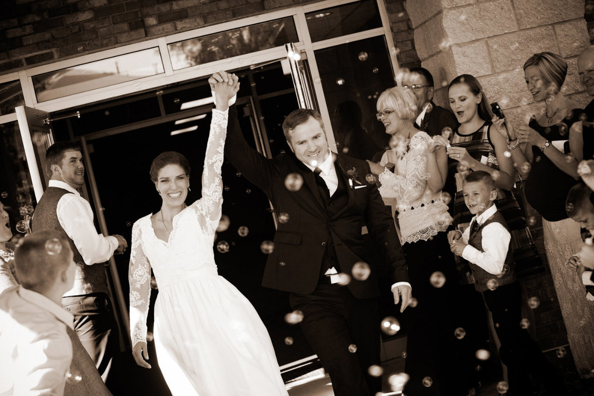 sioux falls wedding photography bride and groom leaving ceremony south dakota