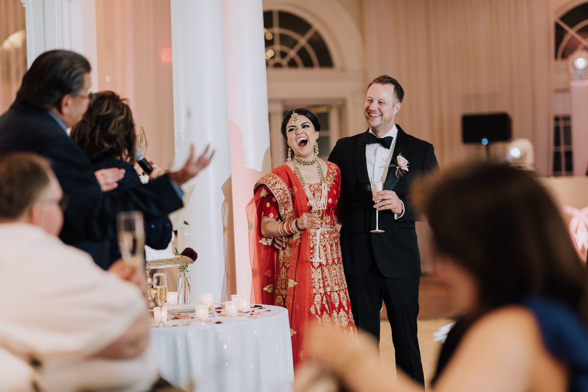 Our newlyweds laugh while hearing their family toast during their big day during their reception in our elegant Pavilion.