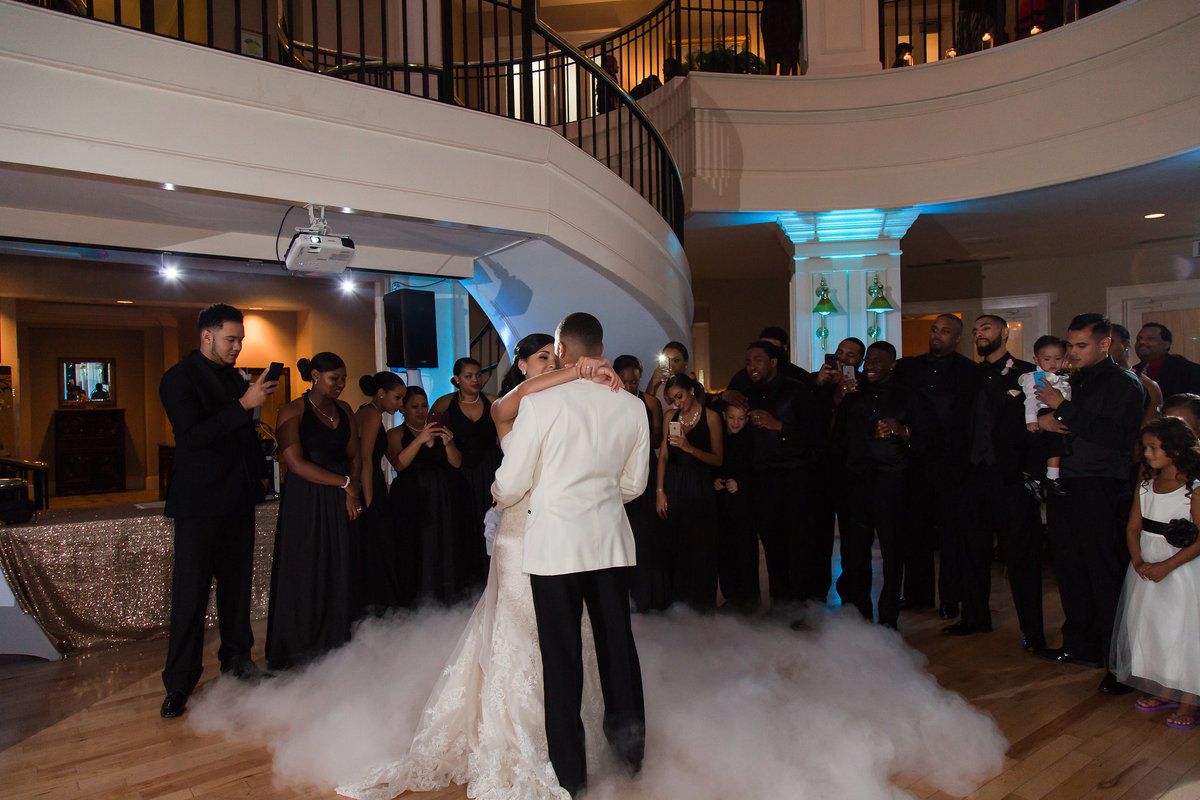 A bride and groom share a foggy first dance at The Dominion Club in Richmond